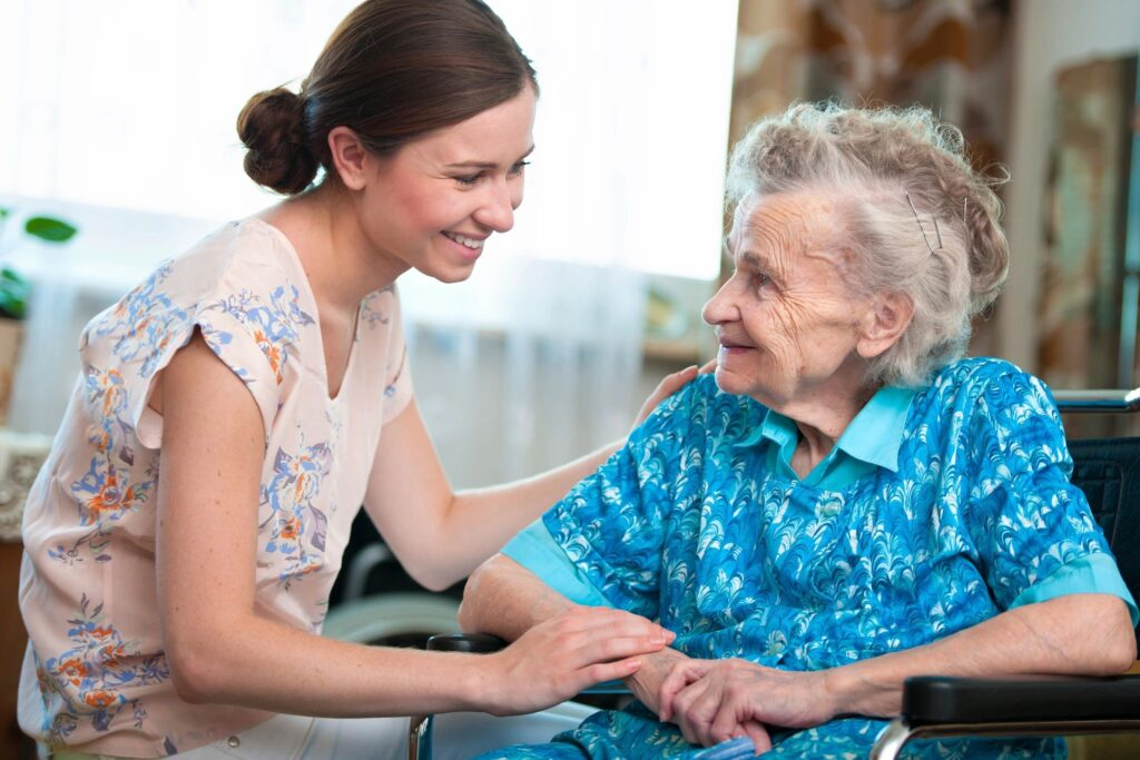 home care worker and old woman